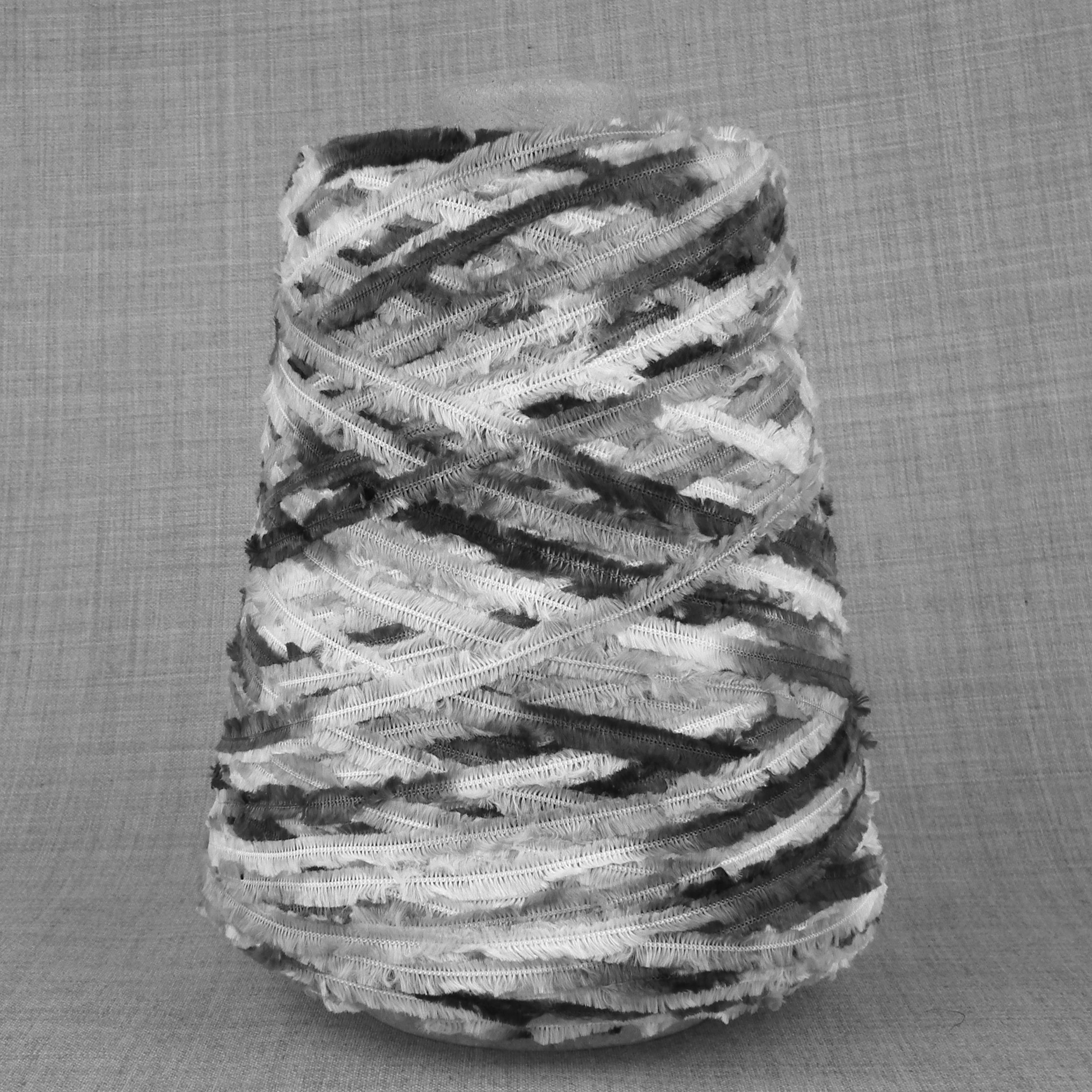 Space dyed feather yarn on cone black white